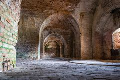 Light entering the brick passages inside Fort Pickens Royalty Free Stock Photography