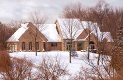 Beautiful Brick Home in the Country in Winter Royalty Free Stock Images