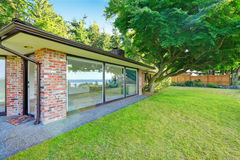 Beautiful brick house with glass walls. Backyard view Stock Photography