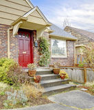 Beautiful brick house with red entrance door Royalty Free Stock Photos