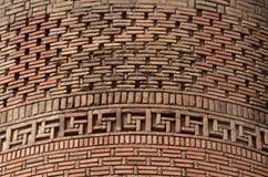 Beautiful brickwork of medieval Uzgen Minaret - ancient town in Osh Region, Kyrgyzstan,Central Asia,unesco heritage stock photography