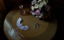 Beautiful bridal accessories on wooden table royalty free stock image
