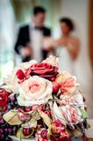 Beautiful bridal bouquet and bride and groom on background, sele Royalty Free Stock Photos