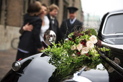 Beautiful bridal bouquet on car bonnet Stock Image