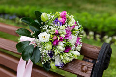 Beautiful bridal bouquet of flowers on the bench Royalty Free Stock Photography