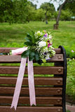 Beautiful bridal bouquet of flowers on the bench Royalty Free Stock Photos
