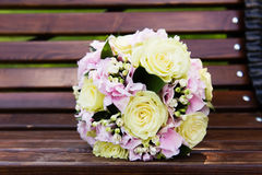 Beautiful bridal bouquet of flowers on the bench Stock Image