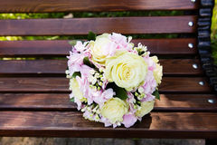 Beautiful bridal bouquet of flowers on the bench Royalty Free Stock Photo