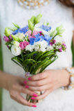 Beautiful bridal bouquet of flowers in hands Royalty Free Stock Photos