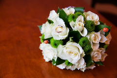 Beautiful bridal bouquet of flowers and wedding rings Stock Image