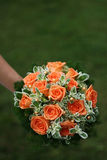 Beautiful bridal bouquet on green Royalty Free Stock Photography