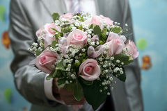 Beautiful Bridal bouquet in the hand of the groom Stock Photos