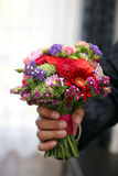 Beautiful Bridal bouquet in the hand of the groom Royalty Free Stock Photo