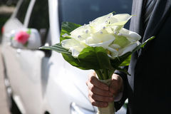 Beautiful Bridal bouquet in the hand of the groom Royalty Free Stock Images