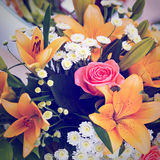 Beautiful bridal bouquet of lilies and roses at  wedding party Royalty Free Stock Photography
