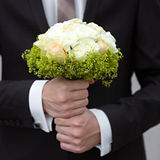 Beautiful bridal bouquet of lilies and roses at  wedding party Royalty Free Stock Images
