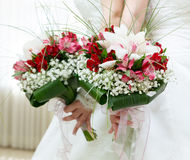 Beautiful bridal bouquet of lilies and roses Stock Photo