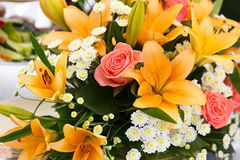 Beautiful bridal bouquet of lilies and roses at  wedding party Royalty Free Stock Photos