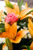 Beautiful bridal bouquet of lilies and roses Stock Image