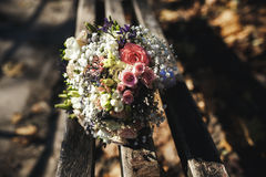Beautiful bridal bouquet lying on a bench Royalty Free Stock Image