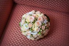 Beautiful bridal bouquet lying on the sofa Stock Photo