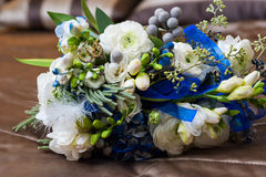 Beautiful bridal bouquet lying on the sofa Stock Images