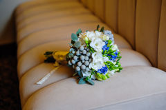 Beautiful bridal bouquet lying on the sofa Royalty Free Stock Image