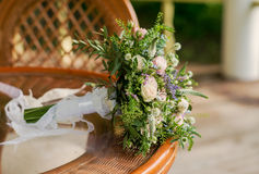 Beautiful bridal bouquet  with ribbons and lace. Bridal bouquet with pink and white colors. Flowers in a rustic style, wedding bouquet on the wooden table Stock Photos