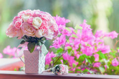 Beautiful bridal bouquet of roses on a green background Stock Photography