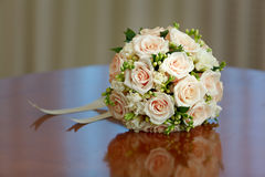 Beautiful bridal bouquet of roses at wedding party Stock Photos