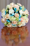 Beautiful bridal bouquet of roses at a wedding party Royalty Free Stock Photos