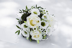 Beautiful bridal bouquet of roses on a wedding. Stock Photos