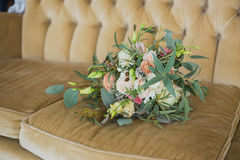 Beautiful bridal bouquet. Bridal bouquet, shot in interior on a vintage couch Royalty Free Stock Image