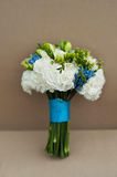 Beautiful bridal bouquet tied with blue silk ribbons. Wedding Accessories Royalty Free Stock Images