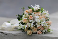 Beautiful bridal bouquet tied with silk ribbons Stock Images