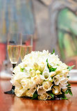 Beautiful bridal bouquet and two glasses of champagne Stock Images
