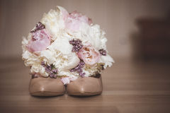 Beautiful bridal bouquet with wedding shoe Stock Images