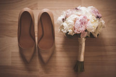 Beautiful bridal bouquet with wedding shoe . top view Stock Photo