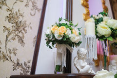 Beautiful bridal bouquet of white and yellow flowers in the interior Royalty Free Stock Photography