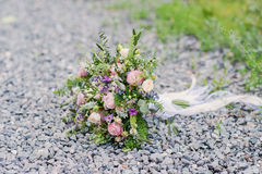 Beautiful bridal bouquet  whith ribbons and lace Royalty Free Stock Photos