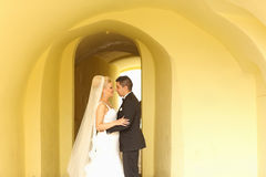 Beautiful bridal couple embracing in hallway Royalty Free Stock Photography