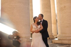 Beautiful bridal couple embracing near columns Stock Photo