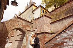 Beautiful bridal couple embracing in old city Royalty Free Stock Photography