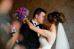 Beautiful bridal couple embracing Stock Photos