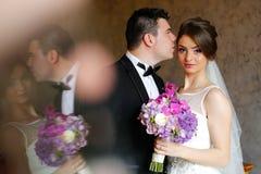 Beautiful bridal couple embracing Royalty Free Stock Images