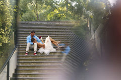 Beautiful bridal couple posing on stairs Royalty Free Stock Photo