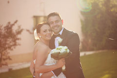 Beautiful bridal couple in the sunlight Royalty Free Stock Photo