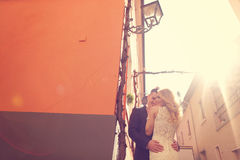 Beautiful bridal couple in the sunlight. Embracing Royalty Free Stock Photography