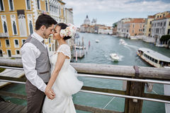 Beautiful bridal couple at sunset on the streets of Venice stock photo