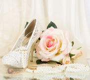 The beautiful bridal shoes, pink rose. And vintage beads Royalty Free Stock Images